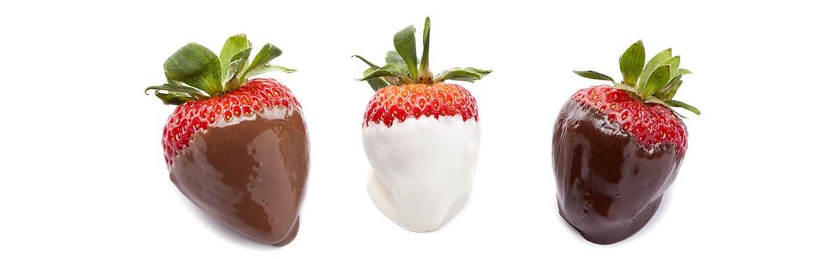 three chocolate dipped strawberries