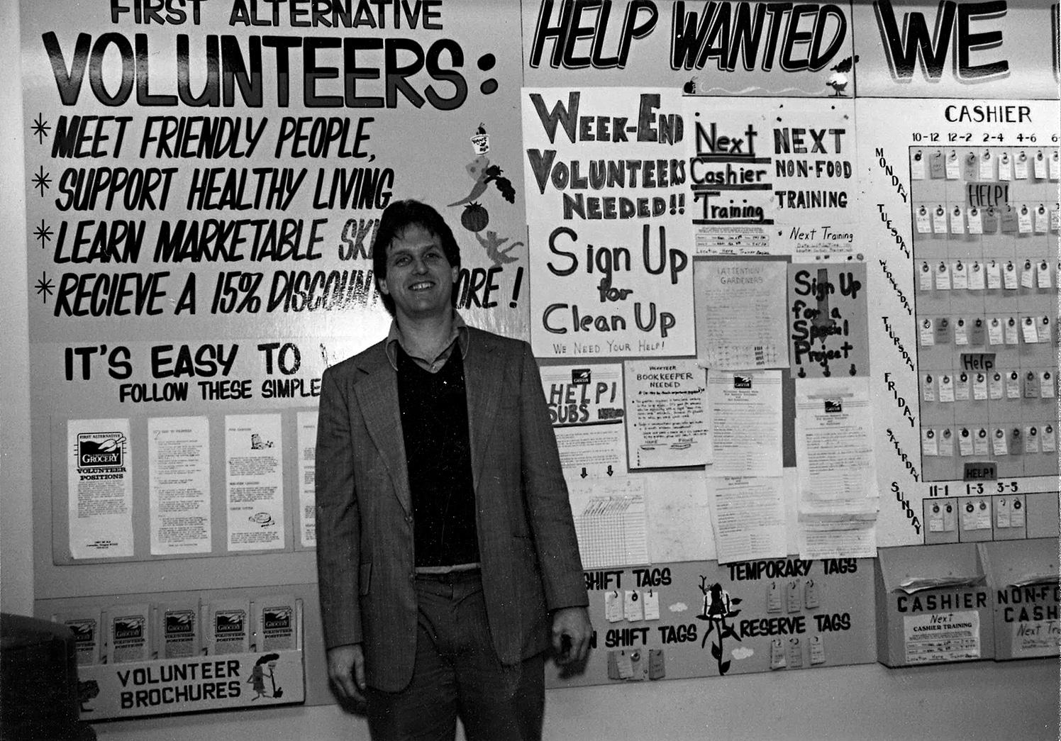 John Lee in front of the Volunteer Wall