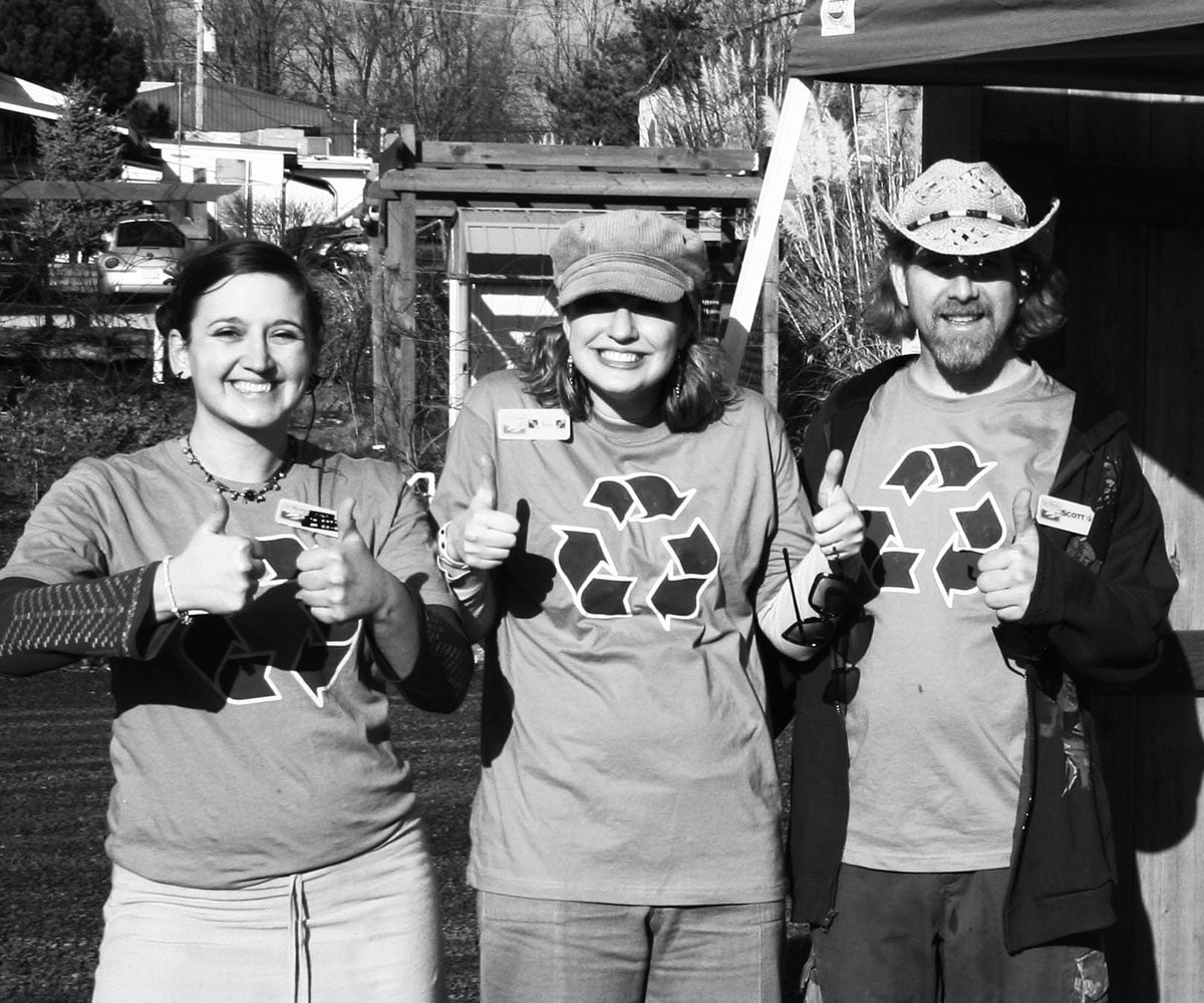 Staff Wearing Shirts with Recycling Symbol Giving the Thumbs Up